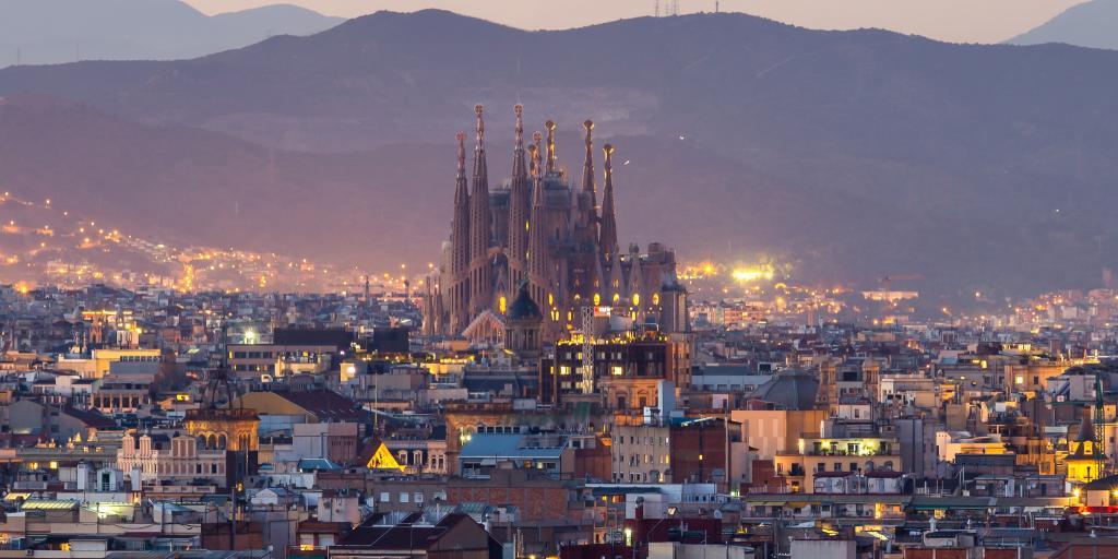 Sagrada Familia against the skyline of Barcelona, Spain, at dusk