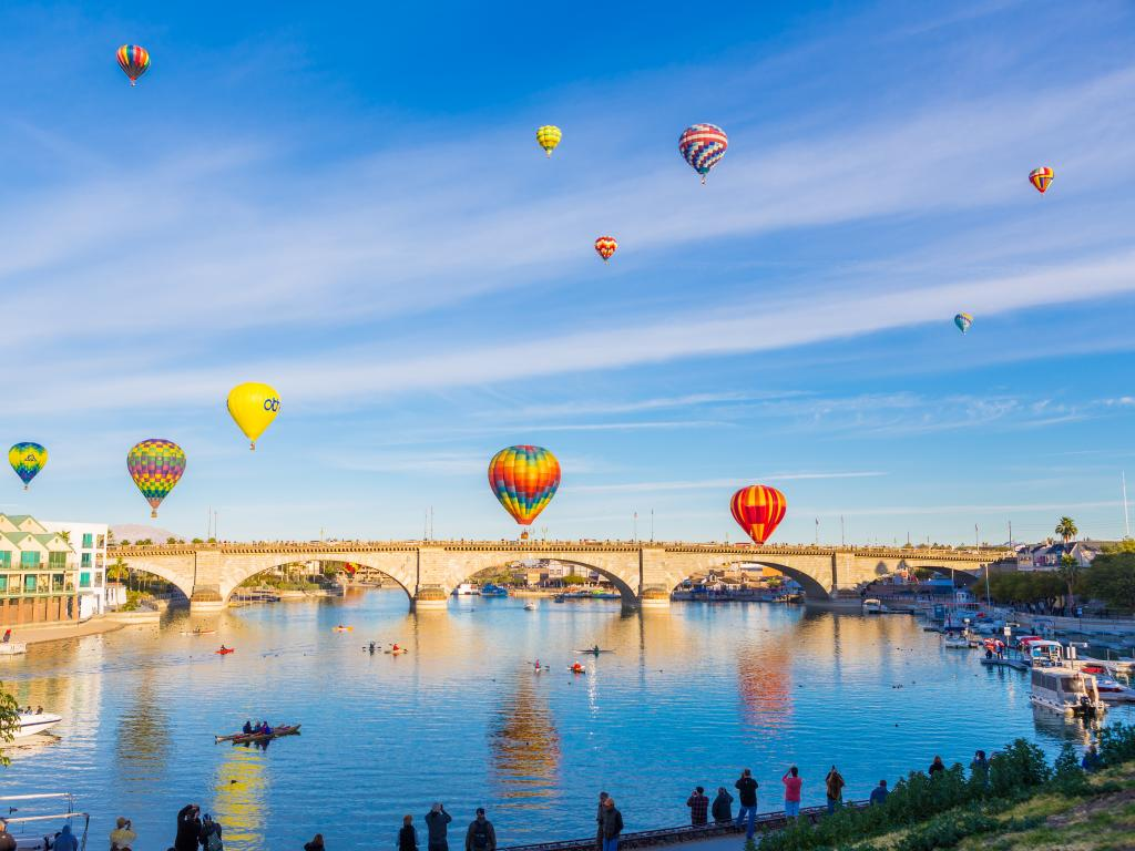 Hot air balloons over the London Bridge at Lake Havasu on the Arizona - California border.