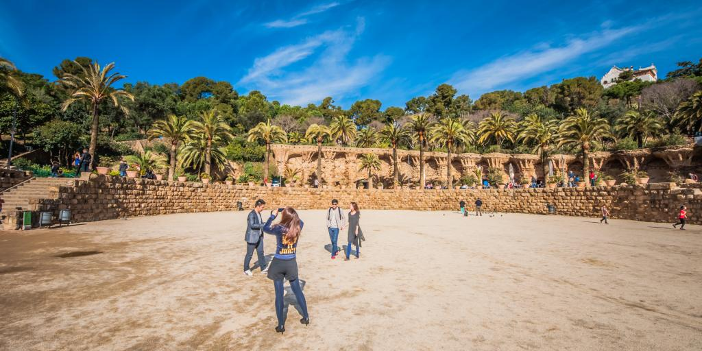Tourists taking pictures on a sunny day in Park Guell, Barcelona