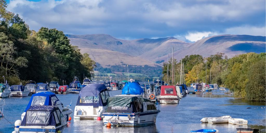 Boats floating in Balloch harbour at Loch Lomond