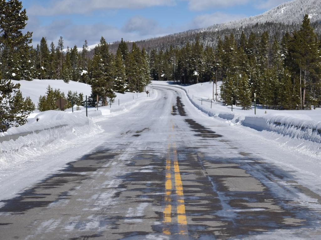 An icy road in the winter in Yellowstone National Park in Wyoming.