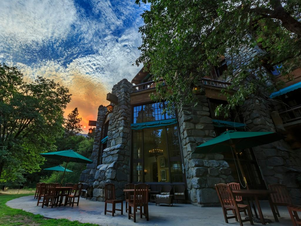 A pleasant day at the famous historical hotel in Yosemite Ahwahnee with trees and canopies outside the hotel