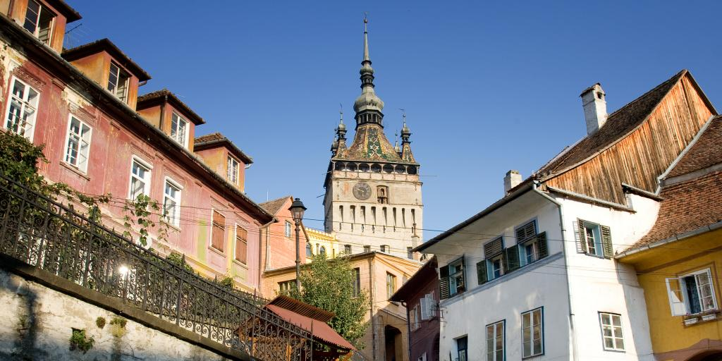 Sighisoara Clock Tower towering above the houses in Romania
