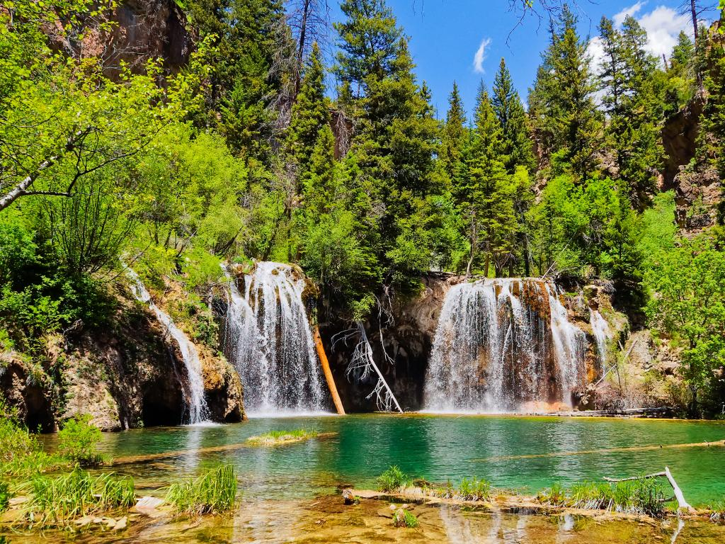 The serene waterfalls flowing into Hanging Lake near Glenwood Springs in Colorado