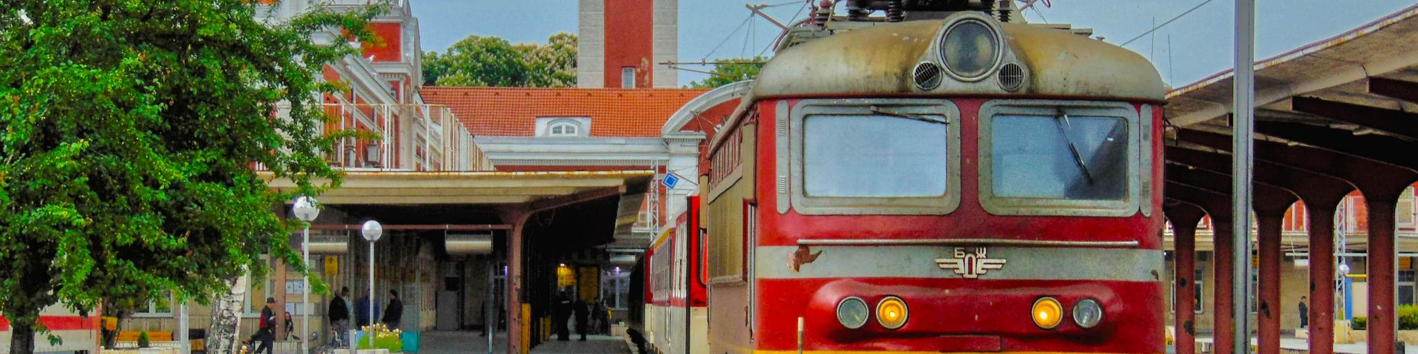 A red train parked at the station in Varna, Bulgaria