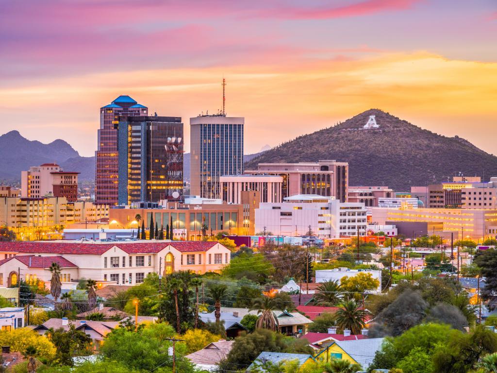 Tucson, Arizona, USA downtown skyline with Sentinel Peak at dusk