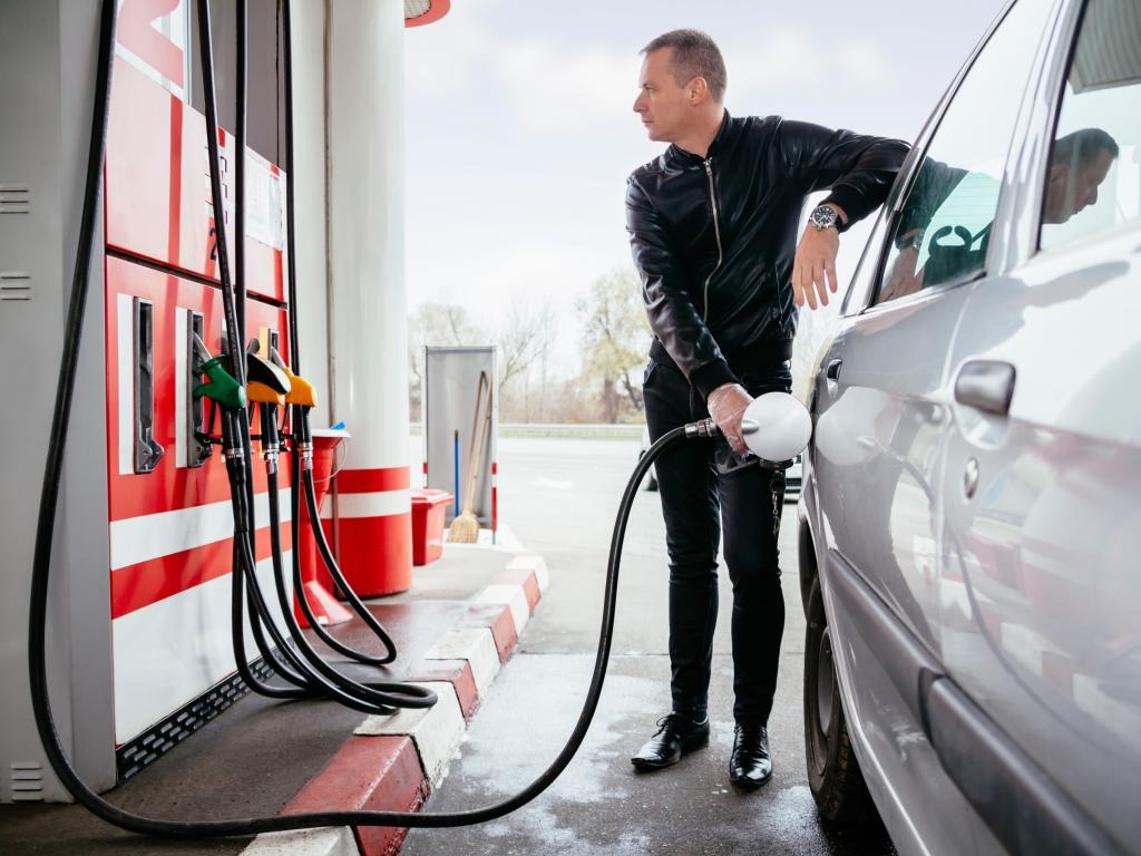 Man filling up his car with gas at the petrol station