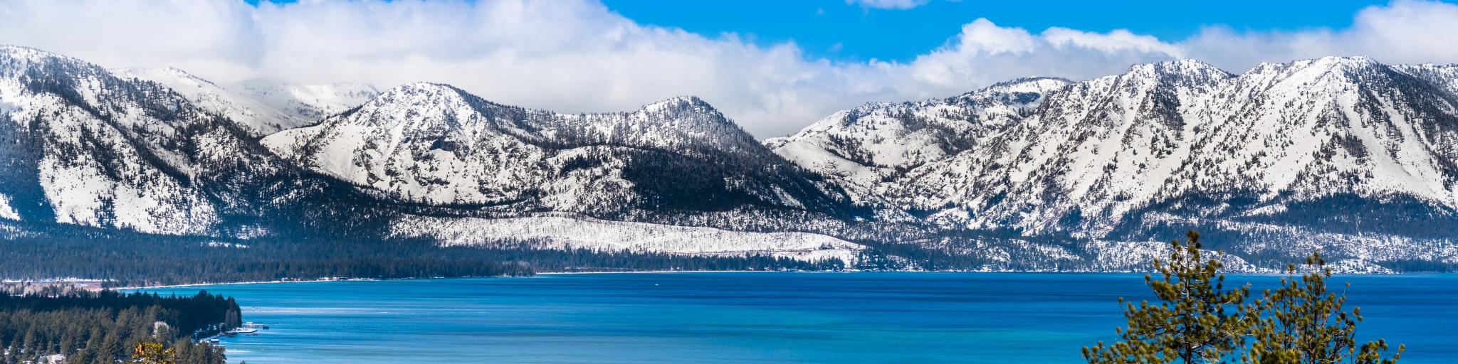 Snow capped Sierra Nevada Mountains behind Lake Tahoe, California