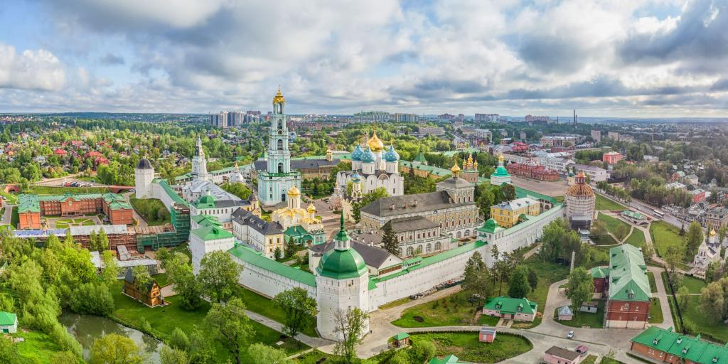 Aerial view of the gold and blue domes of Trinity Lavra of St. Sergius with Sergiev Posad in the background