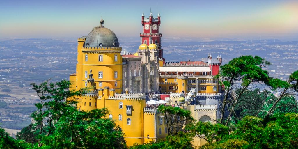 The bright colours and dramatic fairy tale-esque architecture of Pena Palace in Sintra