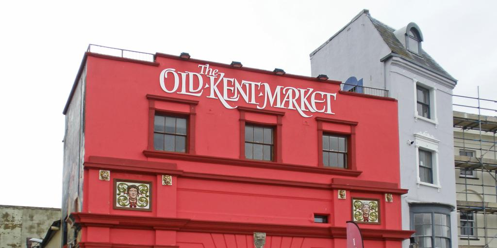 The bright red Old Kent Market stands out on Margate's seafront promenade