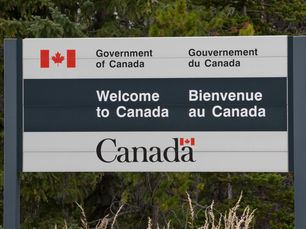 Sign at the border crossing between the United States and Canada saying Welcome to Canada.