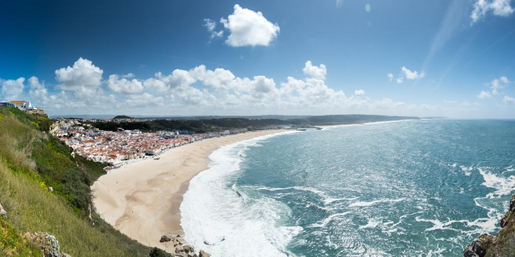 Waves crash onto the shore in Praia da Nazare, Portugal
