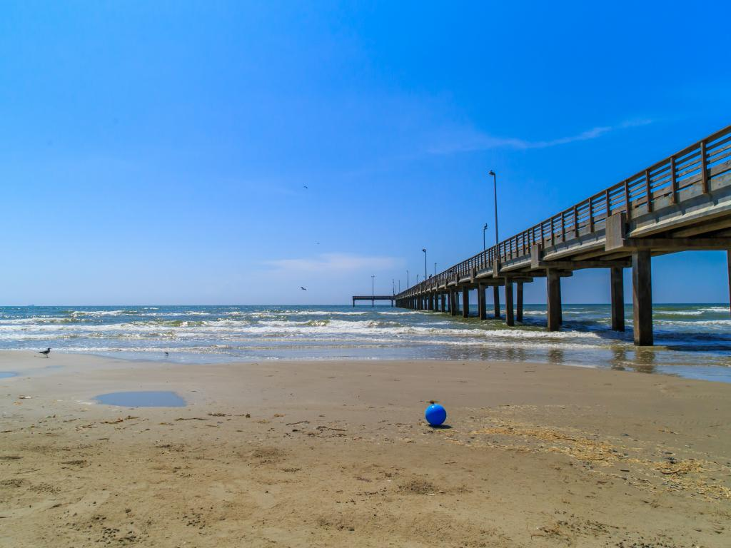 Pier and blue ball by the seat at Port Aransas - Mustang Island State Park