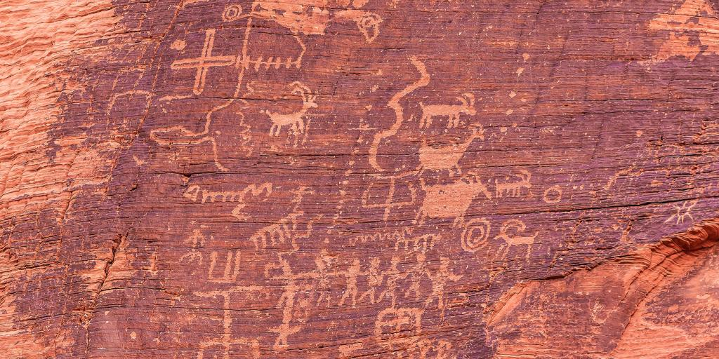 Ancient petroglyphs on red rock in Valley of Fire State Park, Nevada, U.S.A