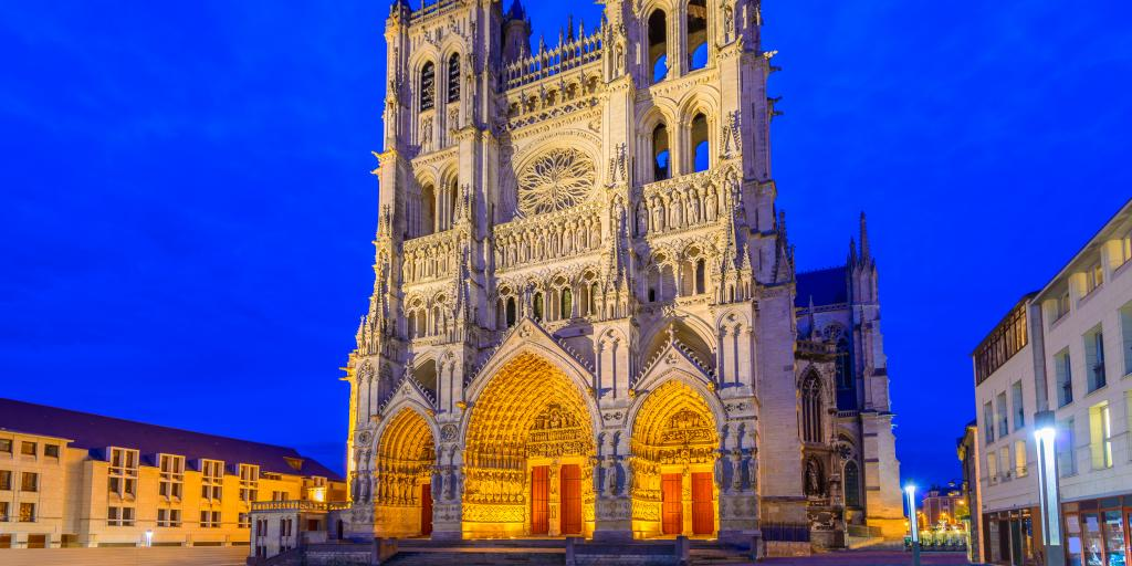 The outisde of Amiens Cathedral, France, lit up at night
