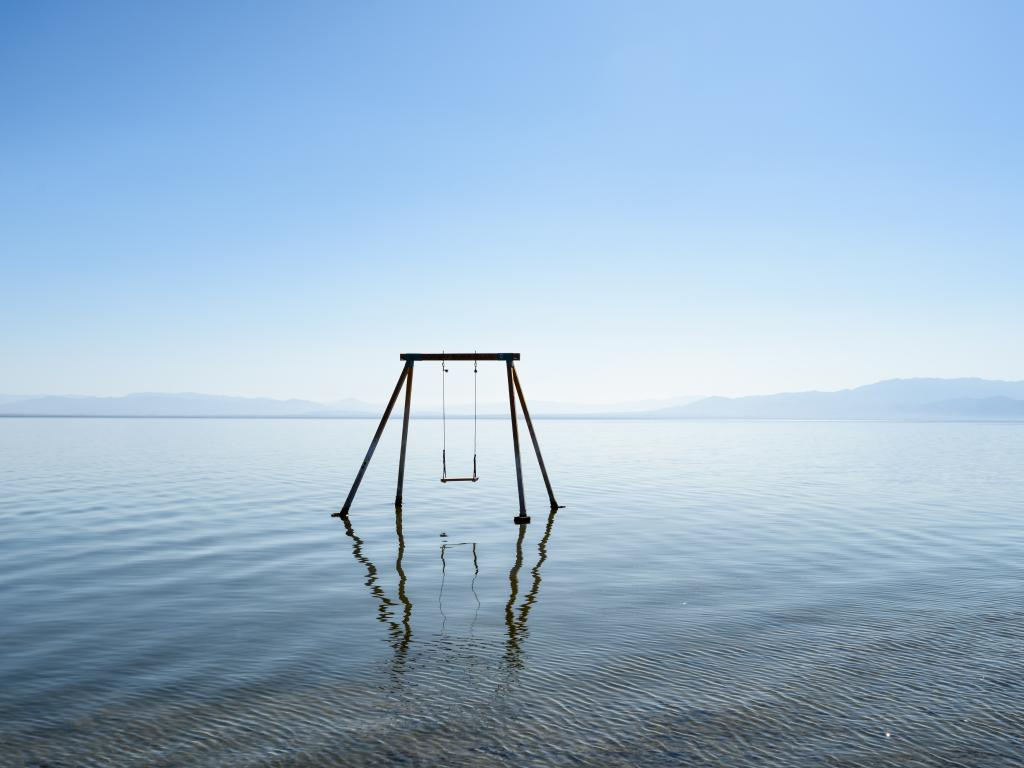 An abandoned rusty swing at Bombay beach in Salton Sea, California.