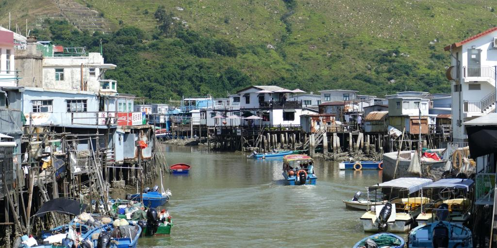 Houses on stilts and boats in the water in the fishing village of Tai O, Hong Kong.