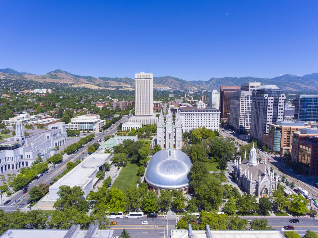 An image that has Temple Square, Salt Lake Temple, LDS Church Office Building in downtown Salt Lake City, Utah on a clear bright sky.