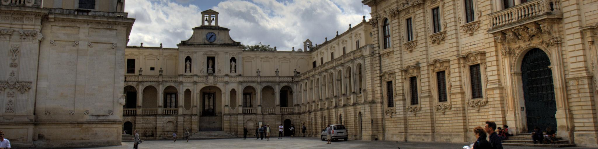People walk around the Piazza Duomo in the town of Lecce, Italy