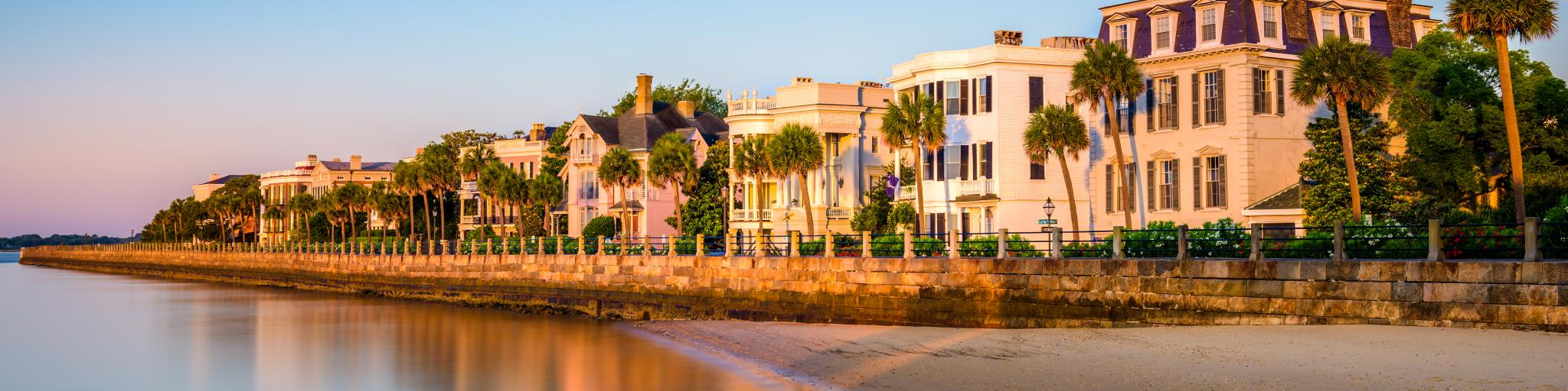 The historic homes near the sea, the Battery in Charleston with beautiful landscape and trees in a clear blue sky morning, South Carolina