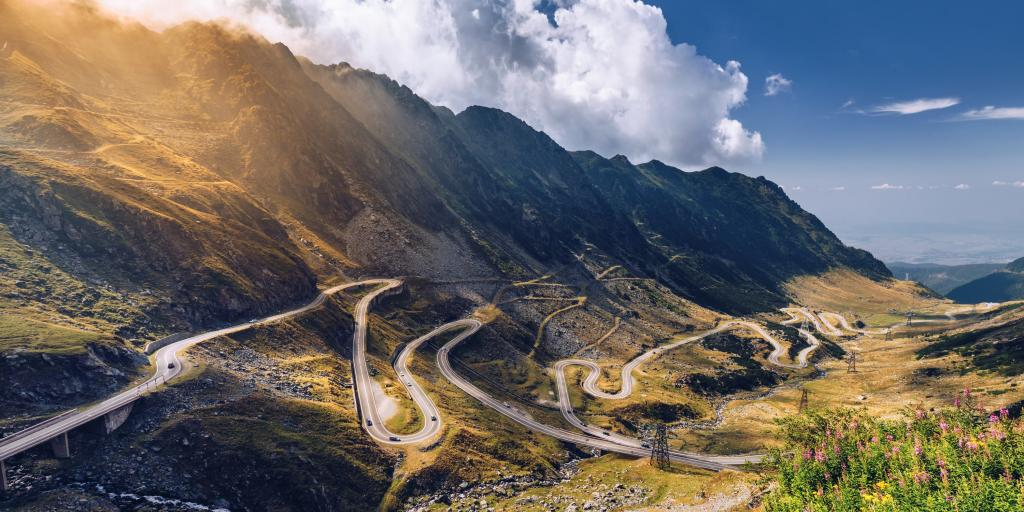 The snaking Transfagarasan pass, Romania, on a sunny summer's day, with the Carpathian mountains in the background.