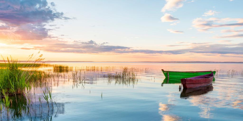 Two small boats on Lake Pleshcheyevo at sunset