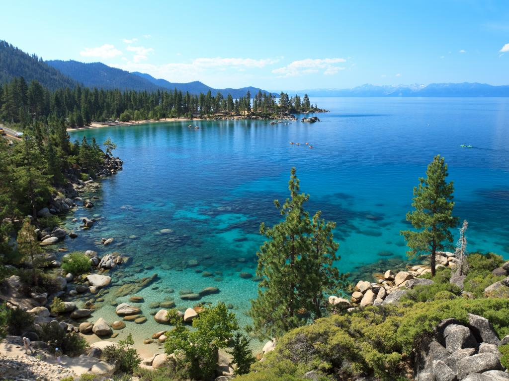 Crystal clear still waters and boulder beach of Lake Tahoe in California