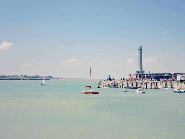 The lighthouse and Harbour Arm just out into the sea in Margate