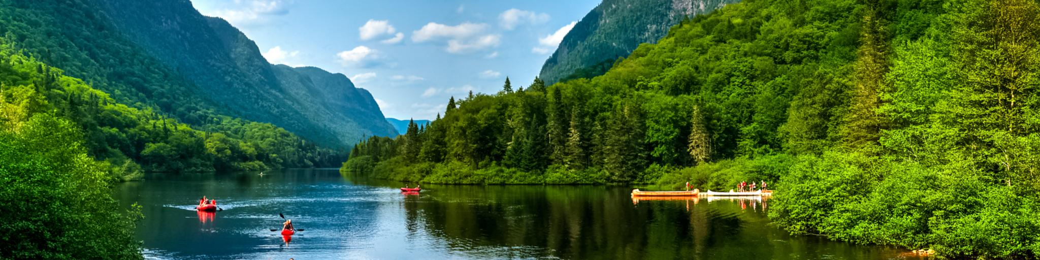 People canoeing and kayaking on a lake in Jacques-Cartier Park, Quebec