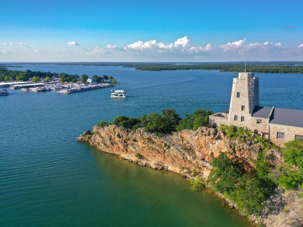 Tucker Tower on a rocky outcrop on Lake Murray in Oklahoma.