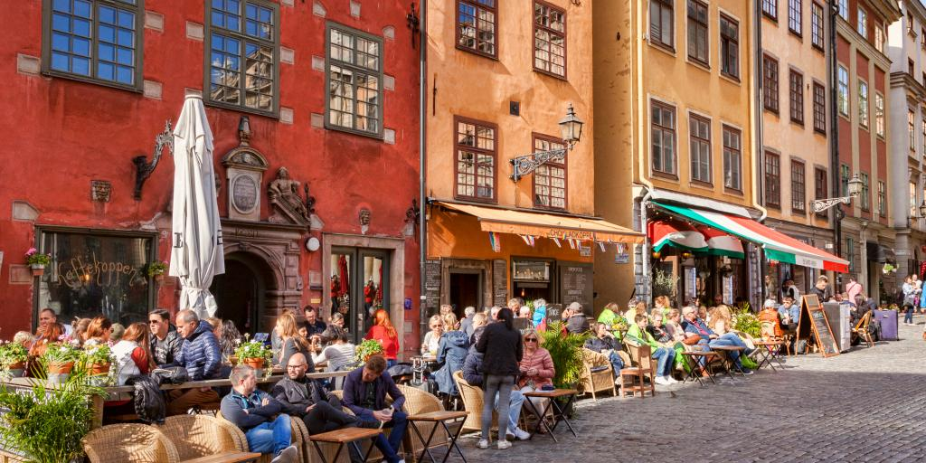 People relaxing in a cafe on Stortorget Square, Stockholm