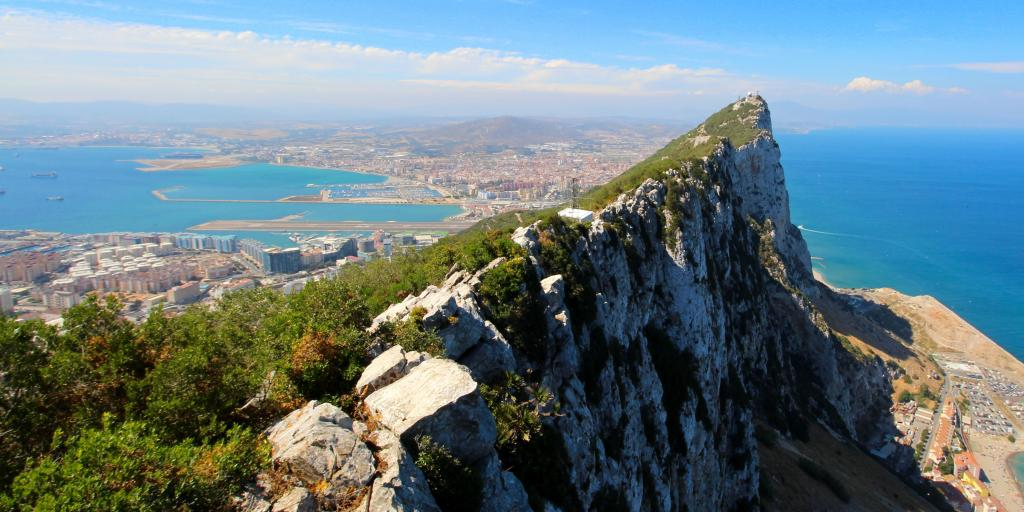 The Rock of Gibraltar stands tall beside the Mediterranean Sea in southern Spain
