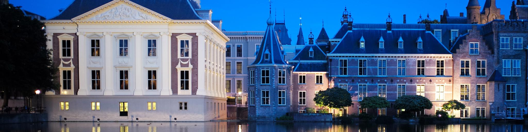 The Mauritshuis Museum and the Torentje in the Hague are lit up by spotlights at dusk
