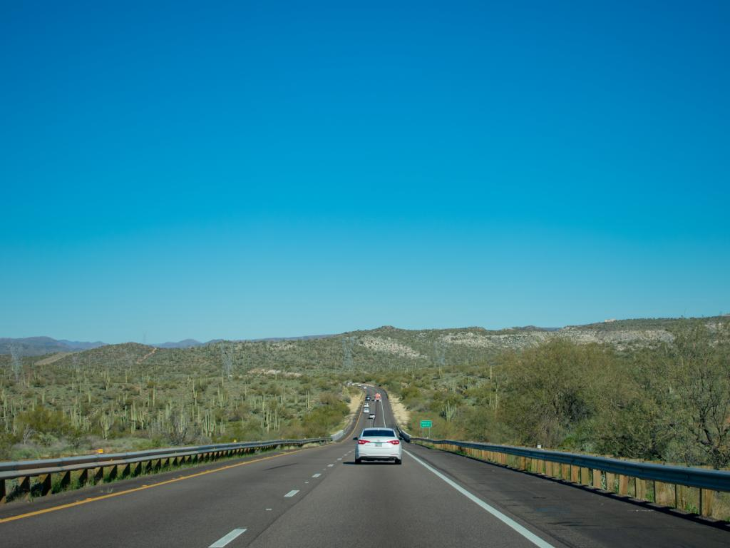 Interstate 17, surrounded by saguaro cactus on a clear sunny day in Pheonix, Arizona.