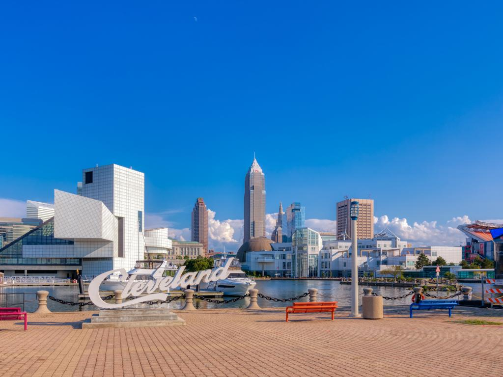 The skyline of Cleveland with Key Bank, Rock and Roll Hall of Fame, and Science Center Building in a cloudy blue sky morning