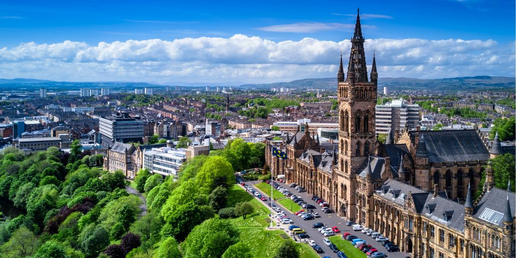 Aerial view of Glasgow University with a blue sky and the city in the background
