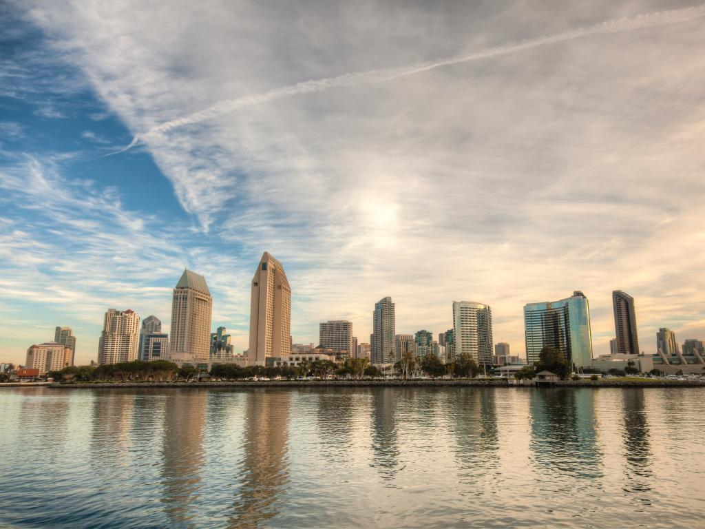 San Diego skyline from across the San Diego Bay on a clear day with light clouds