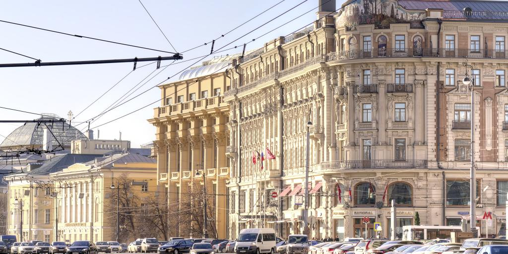 The ornate exterior of the Hotel Nacional, Moscow, with cars visible in front