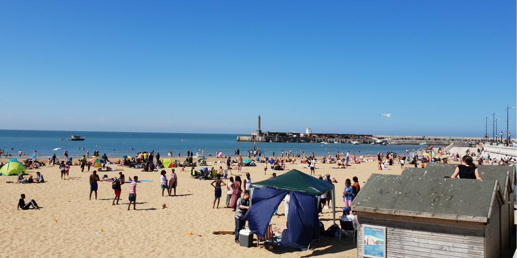 People relaxing in the sun on Margate beach