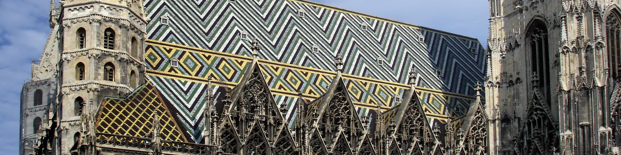 The intricate black, green, blue and yellow tiled roof of St Stephen's Cathedral in Vienna