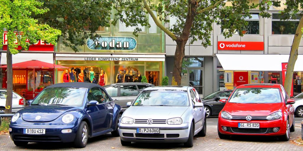 A row of Volkswagen cars parked infront of a shop in Germany