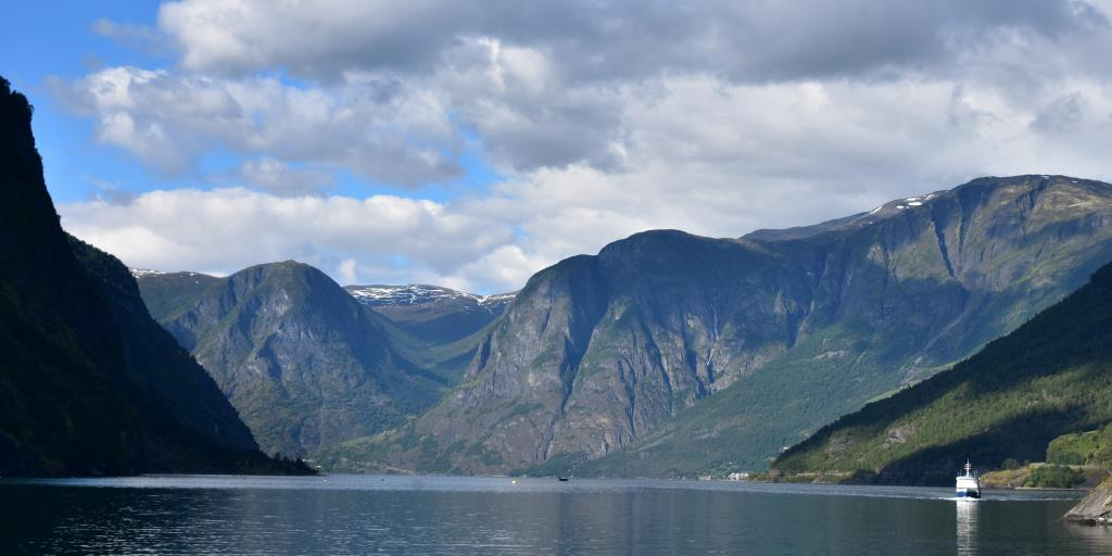 A ferry sails along a fjord near Flam, Norway