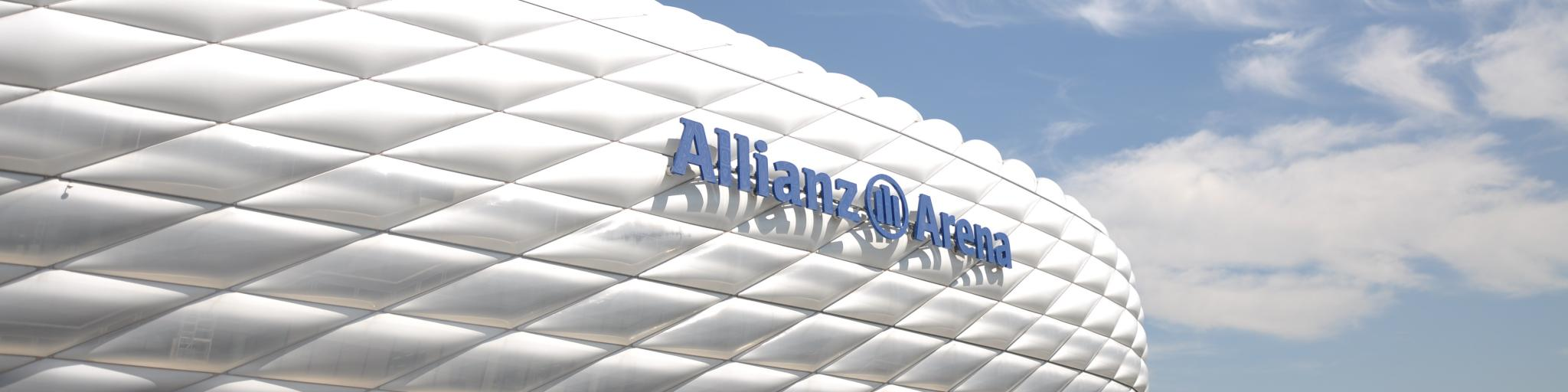 The bubbled, circular exterior of the Allianz Arena, Munich, on a sunny day