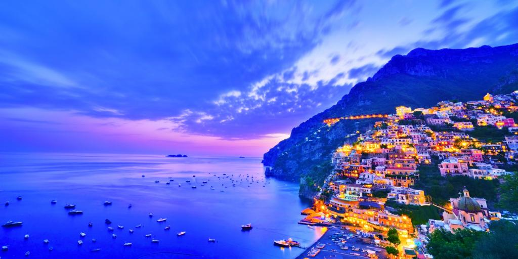 View of Positano village along Amalfi Coast in Italy at dusk
