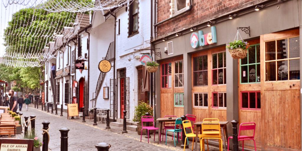 The famous cobbled Ashton Lane in Glasgow is lined with cafes, restaurants and bars