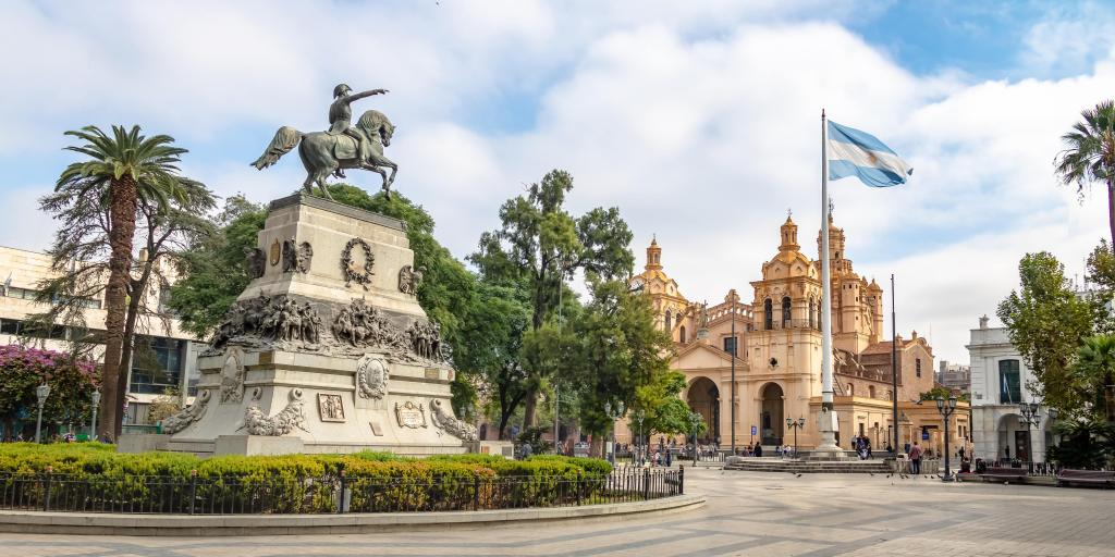 A view of San Martin Square with Cordoba Cathedral and a statue of a man on a horse in the middle