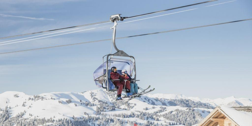 Two people in a chairlift at Gstaad, Switzerland