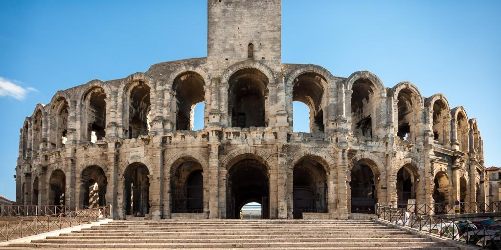 Ruins of the Roman amphitheatre at Arles, France, on a sunny day