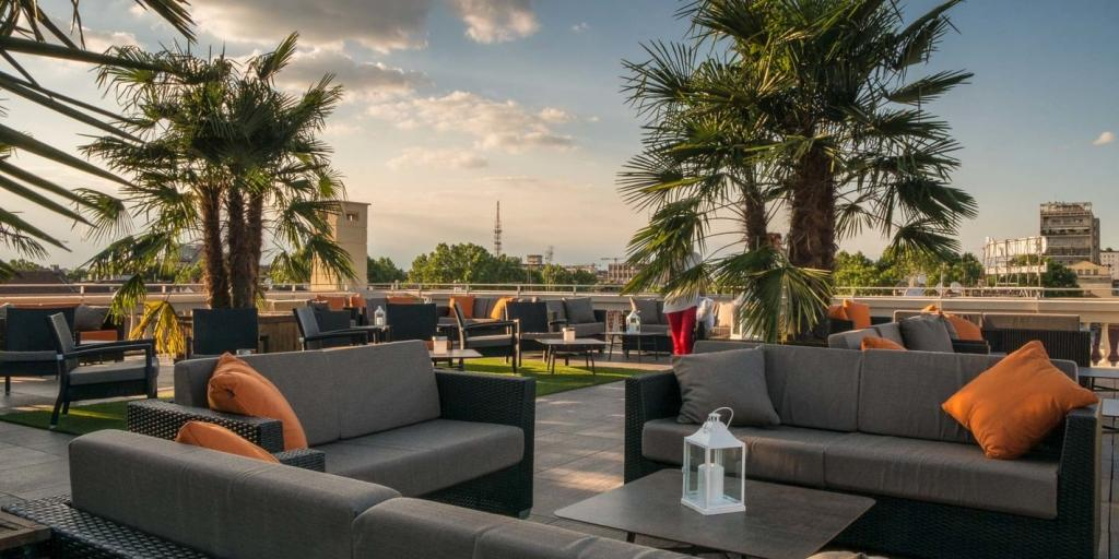 Grey sofas on the Turin Palace Hotel rooftop terrace